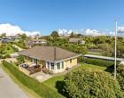 Hus/villa Skøn 1-plans villa i læfyldt have - kun ca. 100 meter fra fjorden